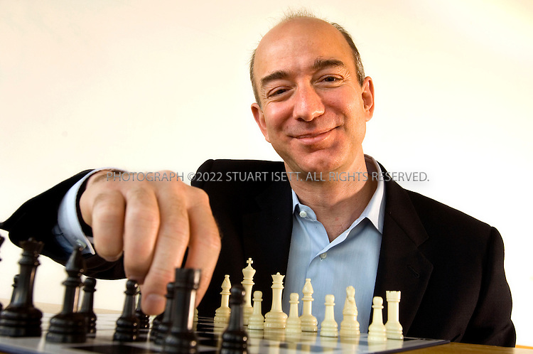 3/21/2007--Seattle, WA, USA..Jeff Bezos, president and CEO of Amazon.com posing with a chess set at Amazon head quarters in Seattle, WA...Photograph ©2007 Stuart Isett.All rights reserved