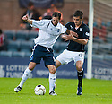 Forfar's Gavin Swankie holds off Dundee's Declan Gallagher.
