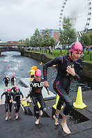 10 AUG 2014 - LIVERPOOL, GBR - Gwen Jorgensen (USA) (right) from the USA heads for transition at the end of the swim during the elite womens wave at the Tri Liverpool triathlon in Kings Dock, Liverpool, Great Britain (PHOTO COPYRIGHT © 2014 NIGEL FARROW, ALL RIGHTS RESERVED)