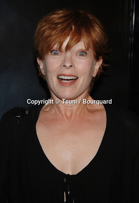 Frances Fisher arriving at the FLAGS OF OUR FATHERS Premiere at the Academy Of Motion Pictures and Sciences  In Los Angeles.<br /> <br /> headshot<br /> surprise<br /> eye contact