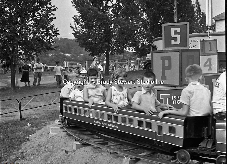 West Mifflin PA:  View of the Kiddieland Express train at Kennywood Park - 1956.  The Stewart family visited Kennywood during the summer of 1956. Kennywood Park is one of the oldest amusement parks in America, founded in 1898. Kennywood Park was a big part of our childhood in the Pittsburgh area. At the end of each school year, most school districts had a Kennywood Park Day.  The rides included the roller coasters; Jackrabbit, Racer and Thunderbolt along the infamous Old Mill where you could steal a kiss or two.  Kennywood was designated a National Historic Landmark since 1987