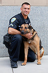 A police officer and his German shepherd who is a trained explosives-detection dog, Santa Monica, California, USA