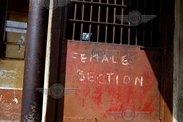 A handwritten notice marking the entrance to the female section of Bo Prison.