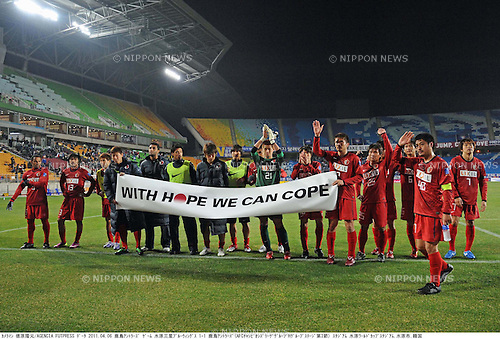 Kashima Antlers team group, APRIL 6, 2011 - Football: Kashima Antlers players hold a banner to show their support to the earthquake victims after the AFC Champions League Group H match between Suwon Samsung Bluewings 1-1 Kashima Antlers at Suwon World Cup Stadium in Suwon, South Korea. (Photo by Takamoto Tokuhara/AFLO)