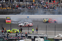 Nov. 8, 2009; Fort Worth, TX, USA; NASCAR Sprint Cup Series drivers Jeff Gordon (24) and Juan Pablo Montoya (42) crash during the Dickies 500 at the Texas Motor Speedway. Mandatory Credit: Mark J. Rebilas-
