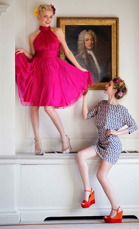 CRY Pure Style Fashion Luncheon in association with Arnotts in the Shelbourne Hotel, are models Teodora  (left),wearing Badgley Mischka fuchsia halter neck dress, ?545 and  Thalia Heffernan, wearing Tara Jarmon blue and orange belted pattern dress, ?280.