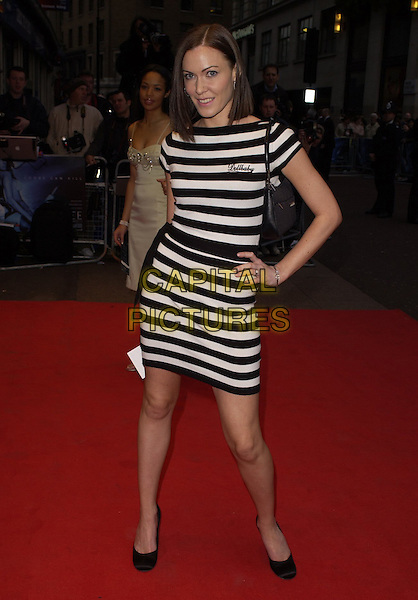 "LINZI STOPPARD.World Premiere of ""Three"" at the Odeon West End, Leicester Square, London, UK..May 2nd, 2006.Ref: CAN.full length black white striped stripes dress Lindsay Lindsey hand on hip.www.capitalpictures.com.sales@capitalpictures.com.©Capital Pictures"