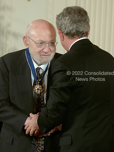 Washington, D.C. - December 15, 2006 -- Joshua Lederberg receives the Presidential Medal of Freedom  from United States President George W. Bush and first lady Laura Bush during a ceremony in the East Room of the White House on Friday, December 15, 2006.  The medal is the nation's highest civil award.  It may be awarded &quot;to any person who has made an especially meritorious contribution to (1) the security or national interests of the United States, or, (2) world peace, or (3) cultural or other significant public or private endeavors&quot;.  Dr. Joshua Lederberg has devoted his life to the advancement of human knowledge across a remarkable range of scientific endeavor.  His work in bacterial genetics earned him a Nobel Prize and laid the groundwork for future progress in the study of genetics.  He has helped develop advanced computer technology, worked with NASA in the search for life on Mars, and served as a distinguished scientific advisor to our Nation&rsquo;s policymakers.  The United States honors Joshua Lederberg for his achievements in scientific discovery and his commitment to improving the lives of others.<br /> Credit: Ron Sachs / CNP