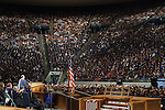 1204-40 1251<br /> <br /> 1204-40 Spring Commencement<br /> <br /> Brigham Young University Graduation<br /> <br /> Commencement Address in the Marriott Center MC, Audience, American Flag, Podium, Speaking<br /> <br /> April 19, 2012<br /> <br /> Photo by Mark A. Philbrick/BYU<br /> <br /> &copy; BYU PHOTO 2012<br /> All Rights Reserved<br /> photo@byu.edu  (801)422-7322
