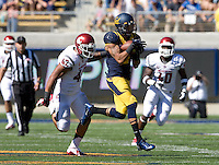 Chris Harper of California catches a pass from Jared Goff during the game against Washington State at Memorial Stadium in Berkeley, California on October 5th, 2013.  Washington State defeated California, 44-22.