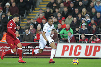 Jordan Ayew of Swansea City moves from Alex Oxlade-Chamberlain of Liverpool during the Premier League match between Swansea City and Liverpool at the Liberty Stadium, Swansea, Wales on 22 January 2018. Photo by Mark Hawkins / PRiME Media Images.