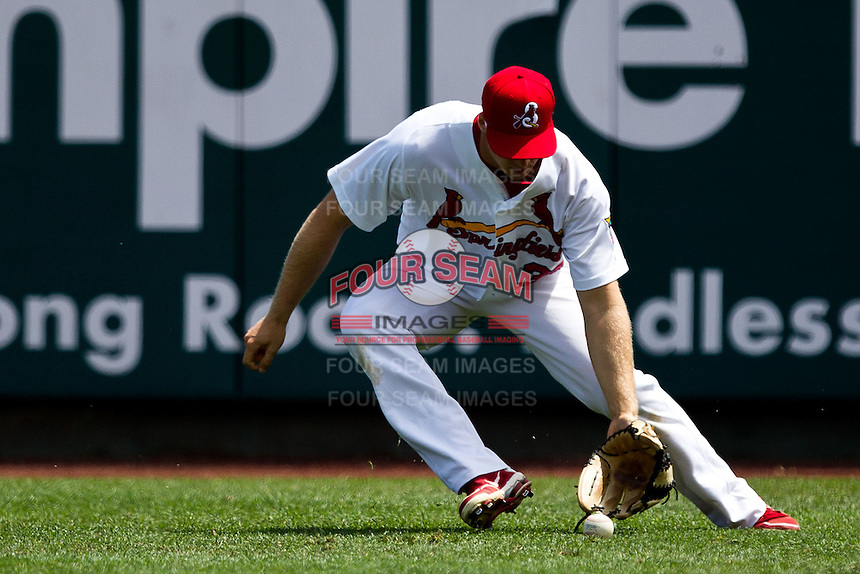 Kyle Conley (35) of the Springfield Cardinals fields a ground ball in right field during a game against the Arkansas Travelers at Hammons Field on May 8, 2012 in Springfield, Missouri. (David Welker/ Four Seam Images).