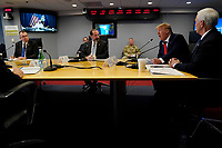 United States President Donald J. Trump, second from right, speaks during a teleconference with governors at the Federal Emergency Management Agency headquarters, Thursday, March 19, 2020, in Washington, DC.  At right is US Vice President Mike Pence and at left center is US Secretary of Health and Human Services (HHS) Alex Azar.<br /> Credit: Evan Vucci / Pool via CNP/AdMedia