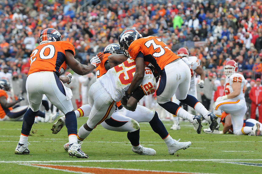 14 NOVEMBER 2010: Chiefs running back Jamaal Charles twists into the end zone for a touchdown   during a regular season National Football League game between the Kansas City Chiefs and the Denver Broncos at Invesco Field at Mile High in Denver, Colorado. The Broncos beat the Chiefs 49-29.