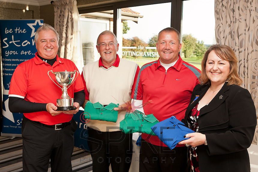 Trophy winners Barry Cockburn, Steve Malson and Morris Steele with Deborah Labbate, tournament organiser