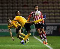 Lincoln City's Matt Green vies for possession with Wolverhampton Wanderers U21's Sadou Diallo<br /> <br /> Photographer Chris Vaughan/CameraSport<br /> <br /> The EFL Checkatrade Trophy Northern Group H - Lincoln City v Wolverhampton Wanderers U21 - Tuesday 6th November 2018 - Sincil Bank - Lincoln<br />  <br /> World Copyright © 2018 CameraSport. All rights reserved. 43 Linden Ave. Countesthorpe. Leicester. England. LE8 5PG - Tel: +44 (0) 116 277 4147 - admin@camerasport.com - www.camerasport.com