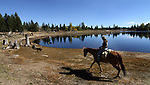 Riders enjoy a trail to Scotts Lake above Hope Valley, Ca. near South Lake Tahoe on Wednesday, Oct. 13, 2010. .Photo by Cathleen Allison