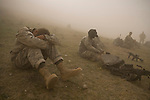 Private Timmy Mitchum, left, of the 82nd Airborne, 1/508 Parachute Infantry Regiment, Alpha Company, Third Platoon waits out a sandstorm at Forward Operations Base Diablo in Kandahar province on Friday, March 30, 2007.