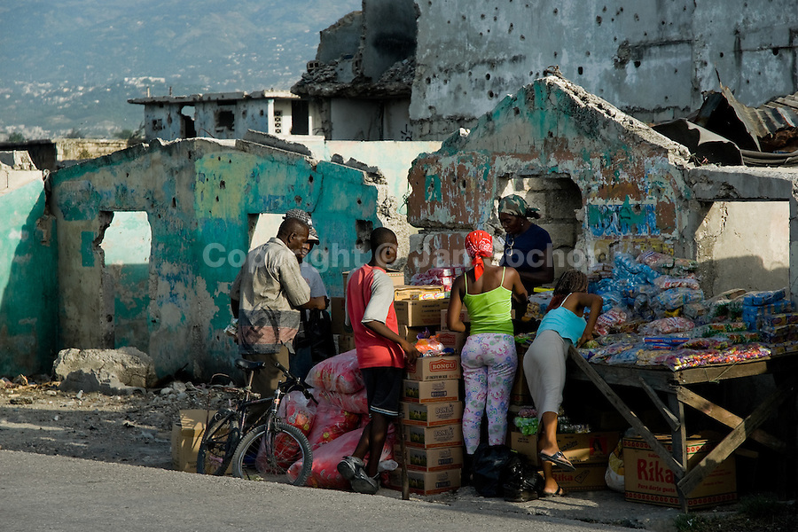 Bullet holes in the wall reveal that violence is present in the slum of Cité Soleil, Port-au-Prince, Haiti, 21 July 2008. Cité Soleil is considered one of the worst slums in the Americas, most of its 300.000 residents live in extreme poverty. Children and single mothers predominate in the population. Social and living conditions in the slum are a human tragedy. There is no running water, no sewers and no electricity. Public services virtually do not exist - there are no stores, no hospitals or schools, no urban infrastructure. In spite of this fact, a rent must be payed even in all shacks made from rusty metal sheets. Infectious diseases are widely spread as garbage disposal does not exist in Cité Soleil. Violence is common, armed gangs operate throughout the slum.