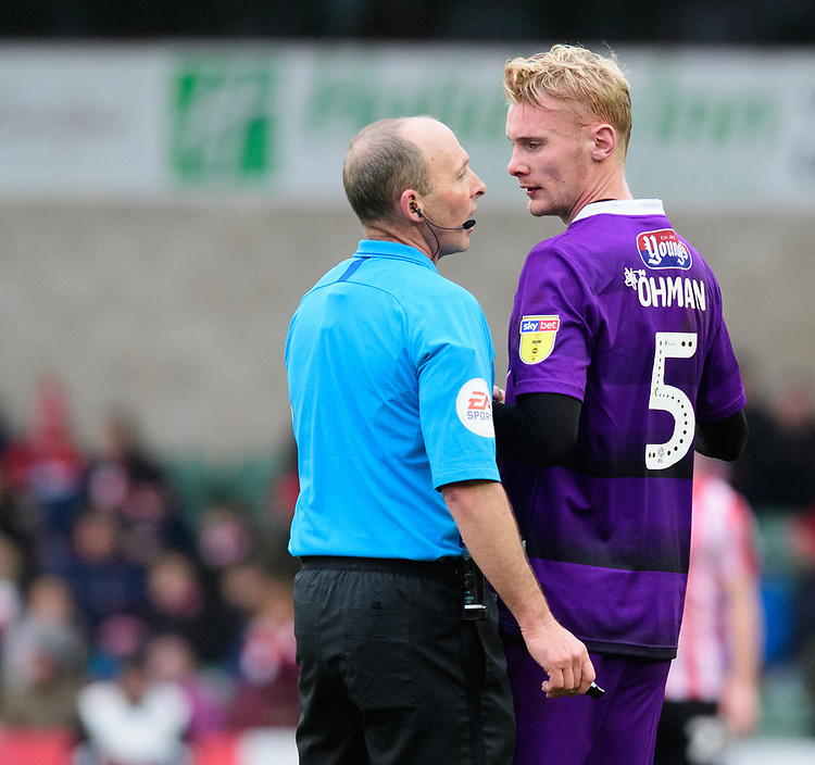 Grimsby Town's Ludvig Ohman speaks to Referee Mike Dean after receiving treatment for an injury<br /> <br /> Photographer Chris Vaughan/CameraSport<br /> <br /> The EFL Sky Bet League Two - Lincoln City v Grimsby Town - Saturday 19 January 2019 - Sincil Bank - Lincoln<br /> <br /> World Copyright &copy; 2019 CameraSport. All rights reserved. 43 Linden Ave. Countesthorpe. Leicester. England. LE8 5PG - Tel: +44 (0) 116 277 4147 - admin@camerasport.com - www.camerasport.com