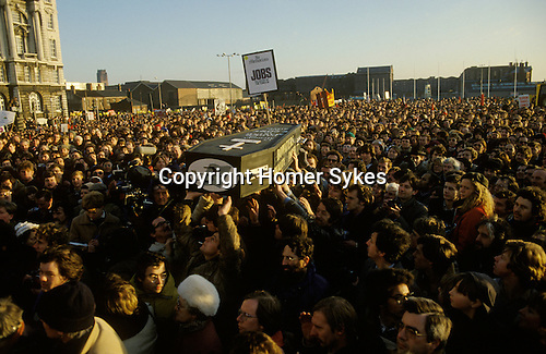 The People's March for Jobs A coffin is carried above the heads of the demonstrators its represents the death of job and workers under the conservative government Rally against unemployment. Liverpool. 1981Rally at the start of the Right to Work march.