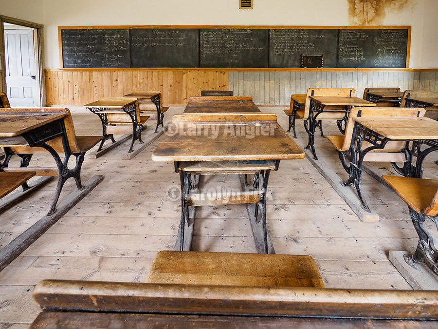 Interior and desks of the one-room school, ghost town of Bannock, Montana, first territorial capital of the region