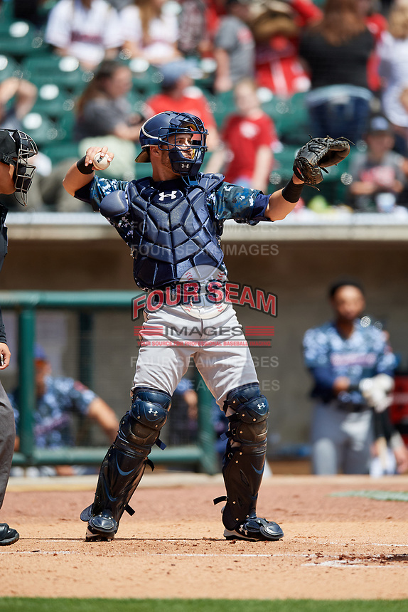 Jacksonville Jumbo Shrimp catcher Cam Maron (7) throws back to the pitcher during a game against the Birmingham Barons on April 24, 2017 at Regions Field in Birmingham, Alabama.  Jacksonville defeated Birmingham 4-1.  (Mike Janes/Four Seam Images)