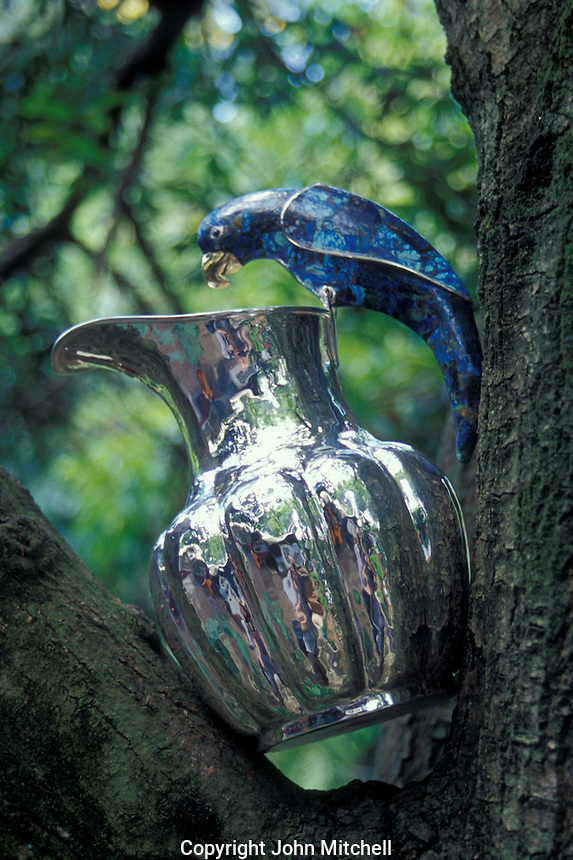 Silver-plated pitcher with parrot-shaped lapis lazuli handle, Los Castillo silver workshop in Taxco Viejo, Guerrero, Mexico