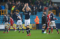 Shaun Hutchinson of Millwall thanks the fans after their 2-0 win in the Sky Bet Championship match between Millwall and Nottingham Forest at The Den, London, England on 30 March 2018. Photo by Alan  Stanford / PRiME Media Images.