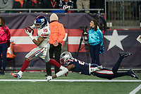 FOXBORO, MA - OCTOBER 10: New York Giants Wide Receiver Golden Tate (15) catches a pass as New England Patriots Defensive back Duron Harmon (21) dives to tackle during a game between New York Giants and New England Patriots at Gillettes on October 10, 2019 in Foxboro, Massachusetts.