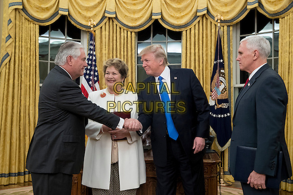 US President Donald J. Trump (2-R) shakes hands with Rex Tillerson (L) after Tillerson was sworn-in as Secretary of State by US Vice President Mike Pence (R), as Tillerson's wife Renda St. Clair (2-L) looks on; in the Oval Office of the White House in Washington, DC, USA, 01 February 2017. Tillerson was confirmed by the Senate, 01 February, in a 56-to-43 vote to become the nation's 69th Secretary of State.<br /> CAP/MPI/RS<br /> &copy;RS/MPI/Capital Pictures