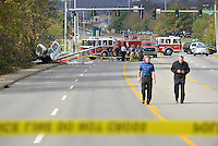 NWA Democrat-Gazette/MICHAEL WOODS &bull; @NWAMICHAELW<br /> Emergency responders work to secure the scene of a small airplane crash on Martin Luther King Blvd in Fayetteville Tuesday November 3, 2015.  Three people were on the aircraft that deployed an emergency parachute attached to the airplane while trying to make an emergency landing at Drake field in Fayetteville after experiencing an oil pressure loss after taking off from the Bentonville airport.