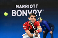 11th January 2020; Sydney Olympic Park Tennis Centre, Sydney, New South Wales, Australia; ATP Cup Australia, Sydney, Day 9; Serbia versus Russia;  Novak Djokovic versus Daniil Medvedev; Novak Djokovic of Serbia reaches for a backhand return in his match against Daniil Medvedev of Russia - Editorial Use