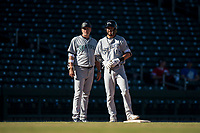 Peoria Javelinas first baseman Weston Wilson (18), of the Milwaukee Brewers organization, talks to manager Daren Brown (43), of the Seattle Mariners organization, during an Arizona Fall League game against the Mesa Solar Sox at Sloan Park on November 6, 2018 in Mesa, Arizona. Mesa defeated Peoria 7-5 . (Zachary Lucy/Four Seam Images)