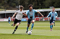 Joshua Gowling of Grimsby Town (2nd right) holds off the Dover attack as Jon Nolan of Grimsby Town looks on (right) during the Vanarama National League match between Dover Athletic and Grimsby Town at the Crabble Athletic Ground, Dover, England on 16 April 2016. Photo by Tony Fowles/PRiME Media Images.