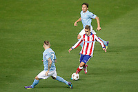 Atletico de Madrid´s Griezmann and Malmo´s Eriksson and Ricardinho during Champions League soccer match between Atletico de Madrid and Malmo at Vicente Calderon stadium in Madrid, Spain. October 22, 2014. (ALTERPHOTOS/Victor Blanco)