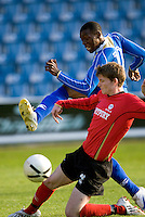 29 APR 2009 - LONDON,GBR - Charlie Mpi - Loughborough University (blue) v UWE Hartpury (red and black) - BUCS Mens Football Championships '09. (PHOTO (C) NIGEL FARROW)