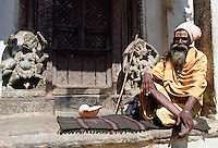Old man at Swayambhunath Stupa  in Kathmandu valley in Nepal a sacred monument in the Buddhist world