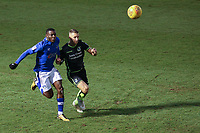 Oldham Athletic's Temitope Obadeyi (left) and Bristol Rovers' Lee Brown (right) in action during the Sky Bet League 1 match between Oldham Athletic and Bristol Rovers at Boundary Park, Oldham, England on 30 December 2017. Photo by Juel Miah / PRiME Media Images.