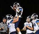 Mater Dei running back Zach Napovanice is hoisted in the air by teammate Bennet Krebs after Napovanice ran in a touchdown. At right watching are teammates Jackson VonBokel and Mitchell Haake (far right). Mater Dei played football at Althoff on Friday September 13, 2019. <br />Tim Vizer/Special to STLhighschoolsports.com