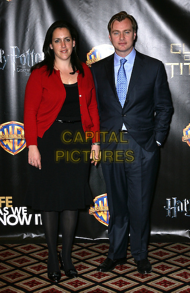EMMA THOMAS & CHRISTOPHER NOLAN .Warner Brothers ShoWest Presentation at the Paris Resort Hotel and Casino, Las Vegas, Nevada, USA..March 18th, 2010.full length black dress red cardigan blue cardigan .CAP/ADM/MJT.© MJT/AdMedia/Capital Pictures.