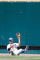 UCLA outfielder Chris Giovinazzo has the ball in Game 13 of the NCAA Division One Men's College World Series on June 26th, 2010 at Johnny Rosenblatt Stadium in Omaha, Nebraska.  (Photo by Andrew Woolley / Four Seam Images)