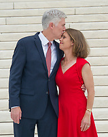 Associate Justice of the Supreme Court of the United States Neil M. Gorsuch, left, and his wife, Marie Louise, right, pose for photos on the front steps of the US Supreme Court Building after the investiture ceremony for Justice Gorsuch in Washington, DC on Thursday, June 15, 2017. Photo Credit: Ron Sachs/CNP/AdMedia
