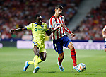 Atletico de Madrid's Alvaro Morata and Getafe CF's Djene Dakonam during La Liga match. Aug 18, 2019. (ALTERPHOTOS/Manu R.B.)Atletico de Madrid's Alvaro Morata and Getafe CF's Djene Dakonam competes for the ball during the Spanish La Liga match between Atletico de Madrid and Getafe CF at Wanda Metropolitano Stadium in Madrid, Spain