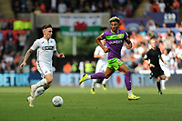 Barrie McKay of Swansea City vies for possession with Lloyd Kelly of Bristol City during the Sky Bet Championship match between Swansea City and Bristol City at the Liberty Stadium, Swansea, Wales, UK. Saturday 25 August 2018