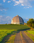 Whitman County, WA      <br /> Morning sun on round barn and gravel road under clearing skies