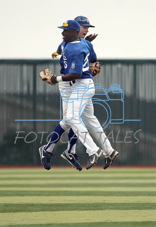 Wildcats outfielders Joseph Crunkilton, rear, and Donald Glover celebrate after both had back-to-back  diving catches in the the first game of a doubleheader against South Mountain Community College, at Western Nevada College in Carson City, Nev., on Friday, Jan. 25, 2013. WNC won the first game 5-1..Photo by Cathleen Allison/Nevada Photo Source.
