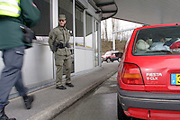 A Special unit of the Swiss army, are reinforcing the effective of the CGFR since the event of 1998, where 2 Gardes Frontière get kill in duty..A Swiss Gardes Frontière control identity document via the RIPOL system, of passengers on a French car at the Bardonnex border, between Switzerland and France in Geneva province..Not all passenger of the vehicular have identity card. The vehicle and is passenger will be return to the French border..