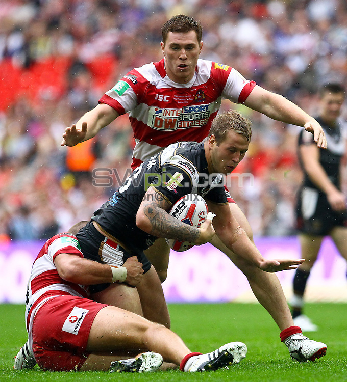 PICTURE BY ALEX WHITEHEAD/SWPIX.COM - Rugby League - 2013 Tetley's Challenge Cup Final - Hull FC v Wigan Warriors - Wembley Stadium, London, England - 24/08/2013 - Hull FC's Joe Westerman is tackled by Wigan's Lee Mossop.