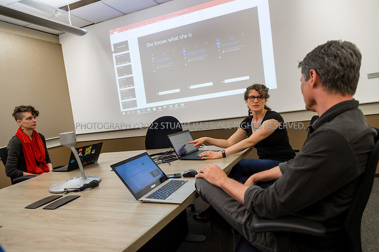 Redmond, WA, United States  &mdash; April 6th, 2016<br /> <br /> Meeting of Microsoft Cortana&rsquo;s writing team &ndash; which includes poets, novelists, playwrights, and a former tv writer on the company&rsquo;s campus in Redmond, WASH., on Wednesday, April 6th 2016. <br /> <br /> Back right: Leading the meeting is Deborah Harrison, writer and Senior Content Developer (short black sleaves) Seated to her left is Chris O&rsquo;Connor, Senior Content Developer (long sleeve black shirt). To his left is Ron Owens, Content Developer (blue shirt). Back left of room is August Niehaus, writer and Content Developer (red scarf) a,d foreground left is Jon Douglas, content developer (red checkered shirt).<br /> <br /> The group, which meets every morning at Microsoft&rsquo;s offices in Redmond, WA, also brainstorms Cortana&rsquo;s responses to new issues. Some members who are shaping Cortana&rsquo;s personality for European and Canadian markets dial in (Cortana is available in Japanese, Italian, German, limited Chinese, and British and Indian English).<br /> <br /> <br /> Photograph by Stuart Isett. &copy;2016 Stuart Isett. All rights reserved.